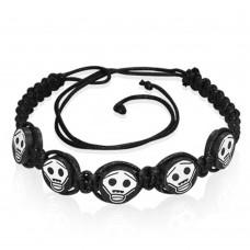 Bracelet with skulls macramé cord. Black