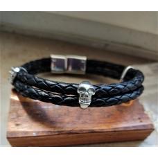 Black leather and steel bracelet. Small skulls