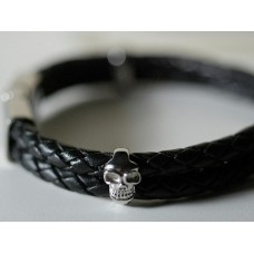 Black leather and steel bracelet. Small skulls