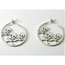 Steel hoop earrings. Three skulls with bones